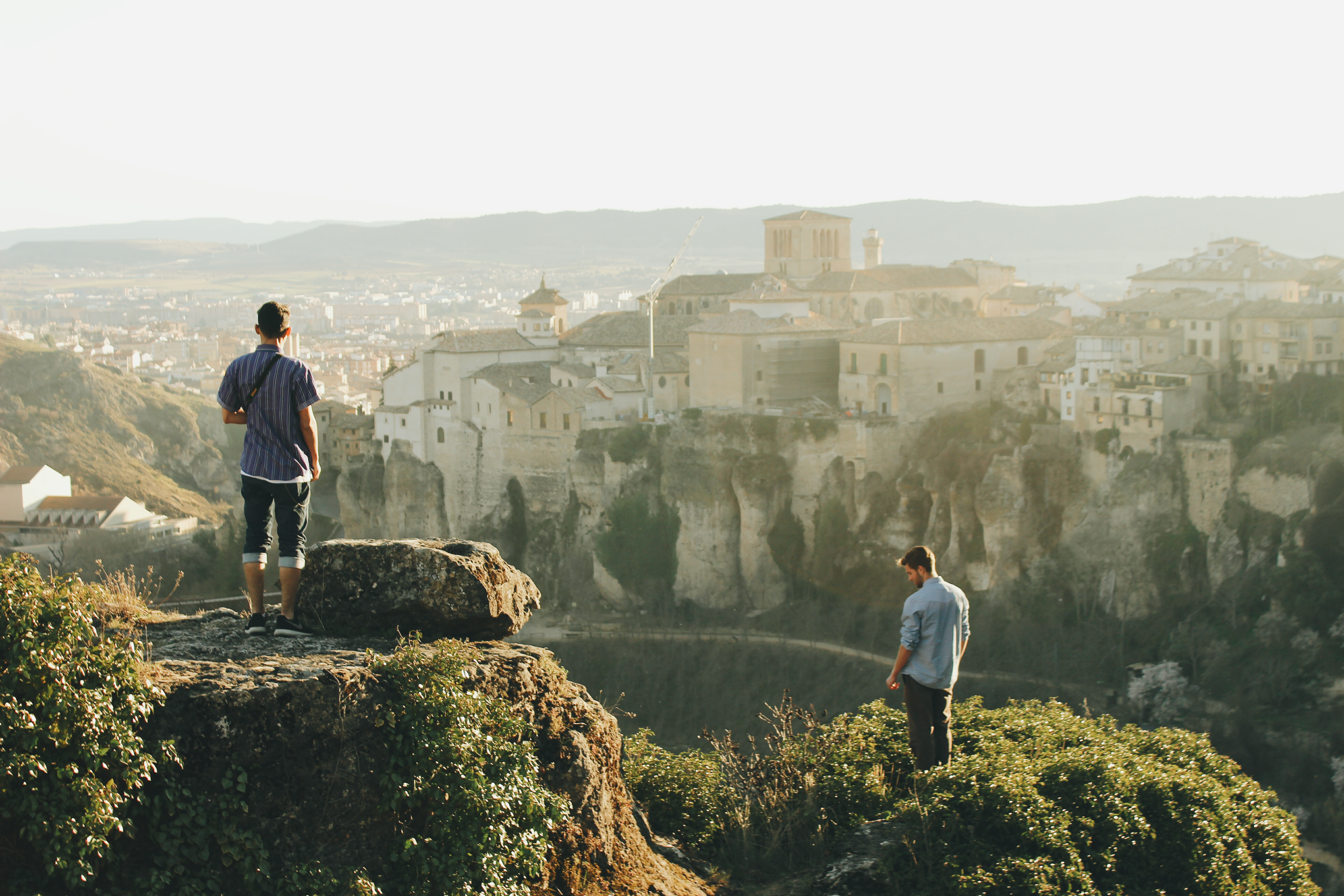 Students on hill tops overlooking ancient city