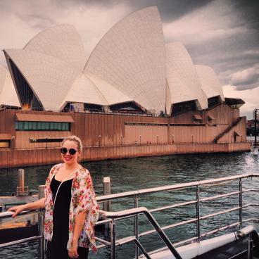 Anna stands in front of iconic Sydney Opera Theater